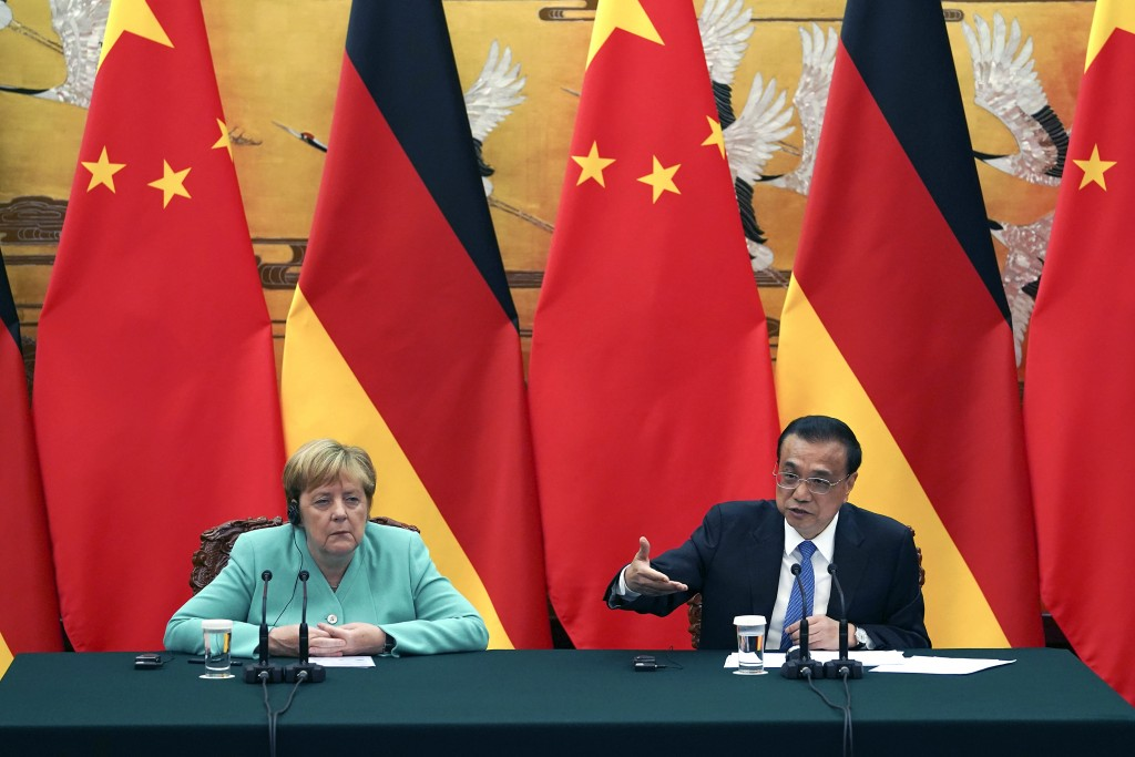 Chinese Premier Li Keqiang gives a speech during the press conference at the end of the meeting with Chancellor of Germany Angela Merkel, left, at The