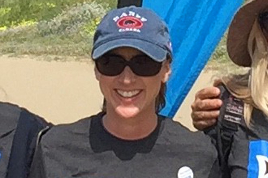 This 2017 photo provided by Heal The Bay shows Marybeth Guiney during a Heal The Bay beach cleanup project at Will Rogers State Beach in the Pacific P...