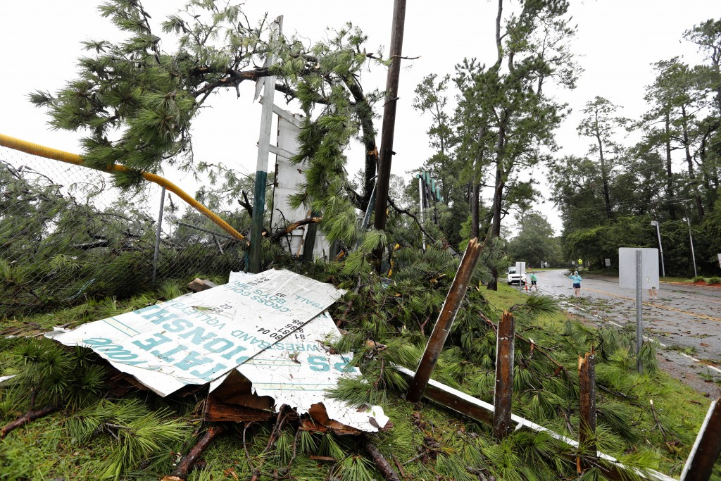 Debris covers the ground including damage to Summerville High School's football stadium's goal post and signage after Hurricane Dorian passed by Thurs...