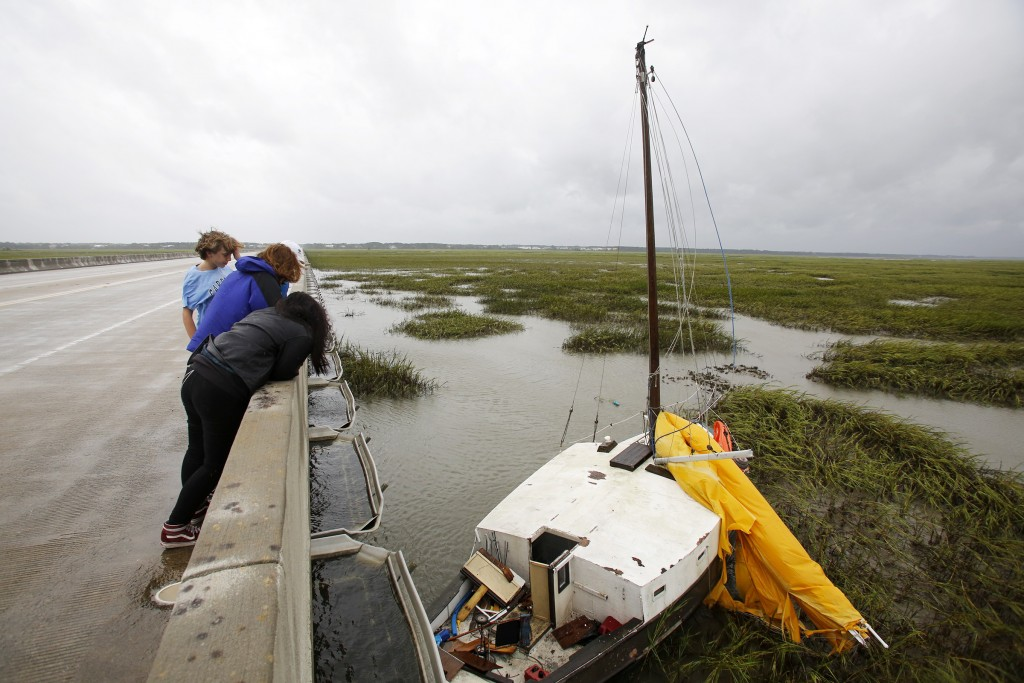 Hurricane watchers look over the Isle of Palms connector at a sailboat that came loose during Hurricane Dorian at the Isle of Palms, S.C., Thursday, S...