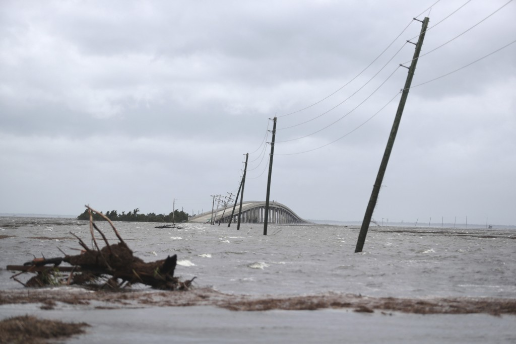 Storm surge from Hurricane Dorian blocks Cedar Island off from the mainland on NC 12 in Atlantic Beach, N.C., after Hurricane Dorian past the coast on...