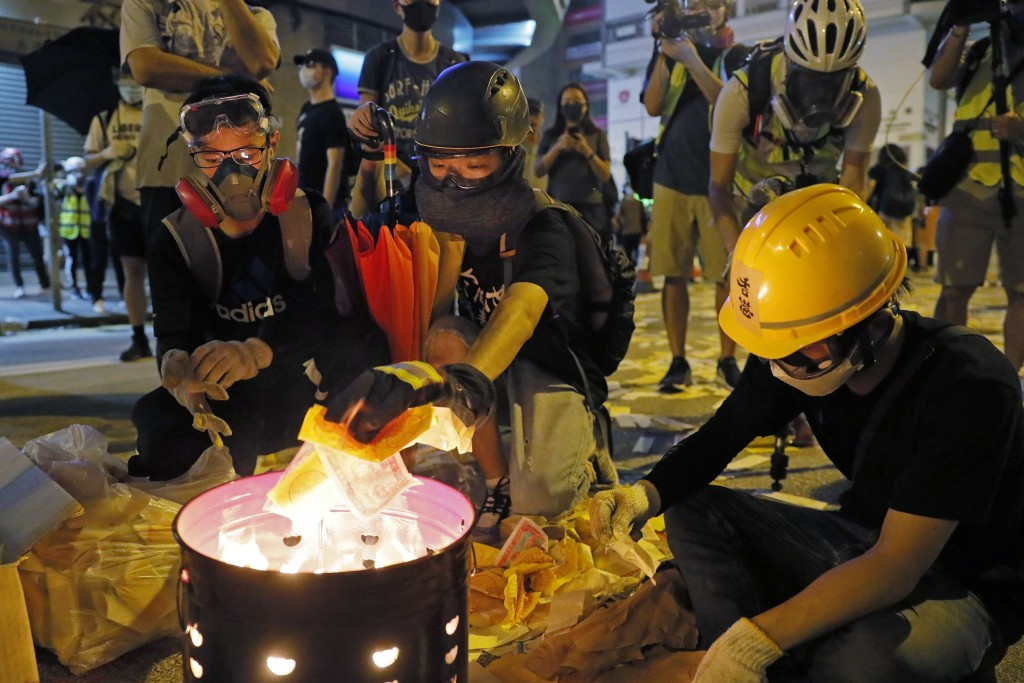 Protesters burn paper money to pay their respects for protesters who were injured on Aug 31 outside Prince Edward station in Hong Kong on Friday, Sept