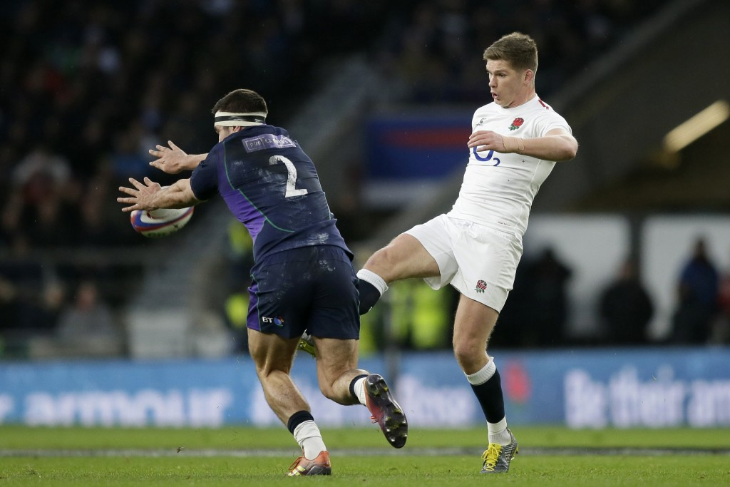 FILE - In this March 16, 2019 file photo, England's Owen Farrell, right, clears the ball during the Six Nations rugby union international between Engl...