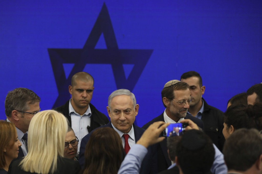 Israeli Prime Minister Benjamin Netanyahu leaves following a press conference in Tel Aviv, Israel, Tuesday, Sept. 10, 2019. Netanyahu vowed Tuesday to...