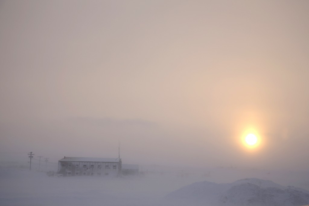 In this Feb. 13, 2019, photo, the afternoon sun hangs low as it shines through the snow at the airport in Nome, Alaska. Survivors and advocates conten...