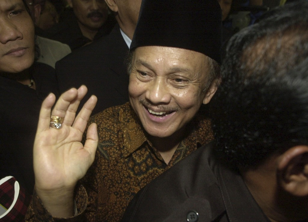 FILE - In this March 20, 2003, file photo, former Indonesian President B. J. Habibie waves to journalists as he arrives to testify in the trial of for...
