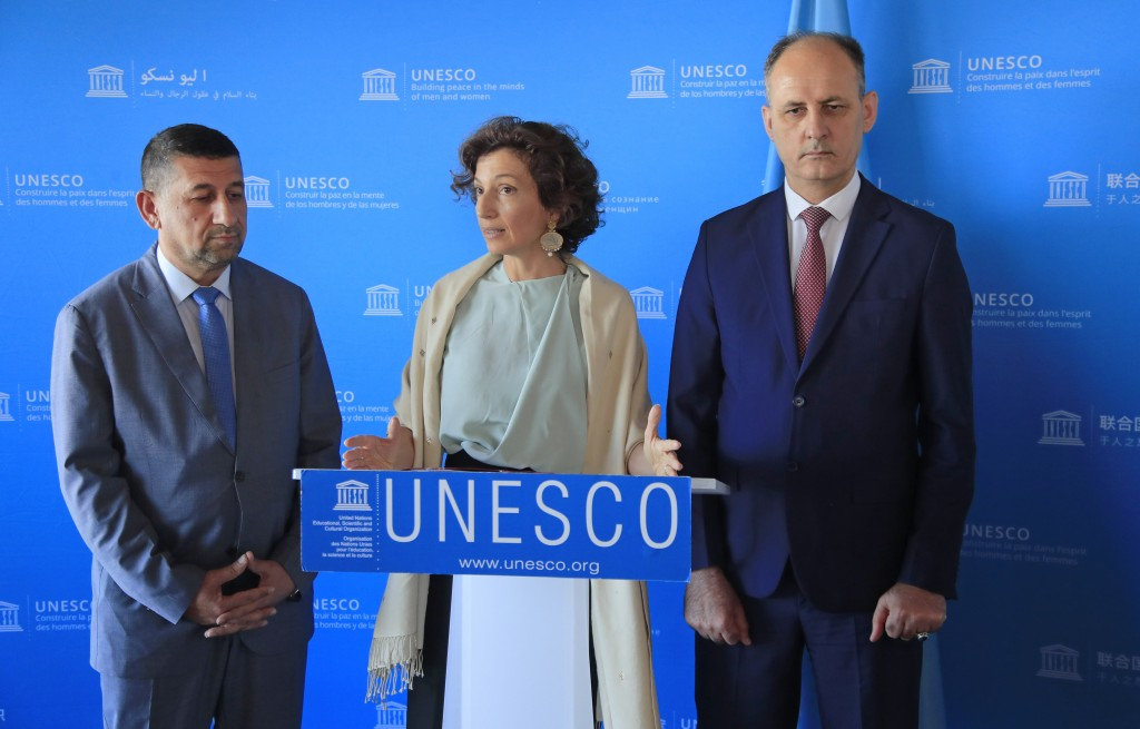 Governor of the province Nineveh Mansour al-Mareed, left, UNESCO'S Director-General Audrey Azoulay , center, and Iraq's Culture Minister Abdulamir al-...