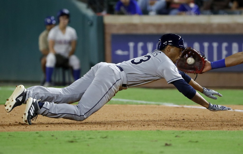 Tampa Bay Rays pinch-runner Johnny Davis is picked off trying to get back to first by a throw from Texas Rangers relief pitcher Ian Gibaut to first ba...