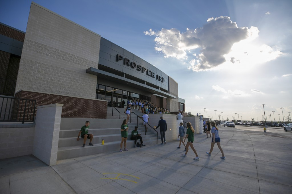 People walk to the entrance during the opening of the new Children's Health Stadium at Prosper ISD on Saturday, Aug. 17, 2019, in Prosper, Texas. Demo...
