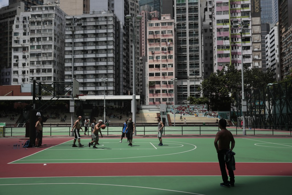 In this Sept. 1, 2019, photo, a group of people play basketball at Southorn Playground, where hundreds of people gathered the day before to protest ag...