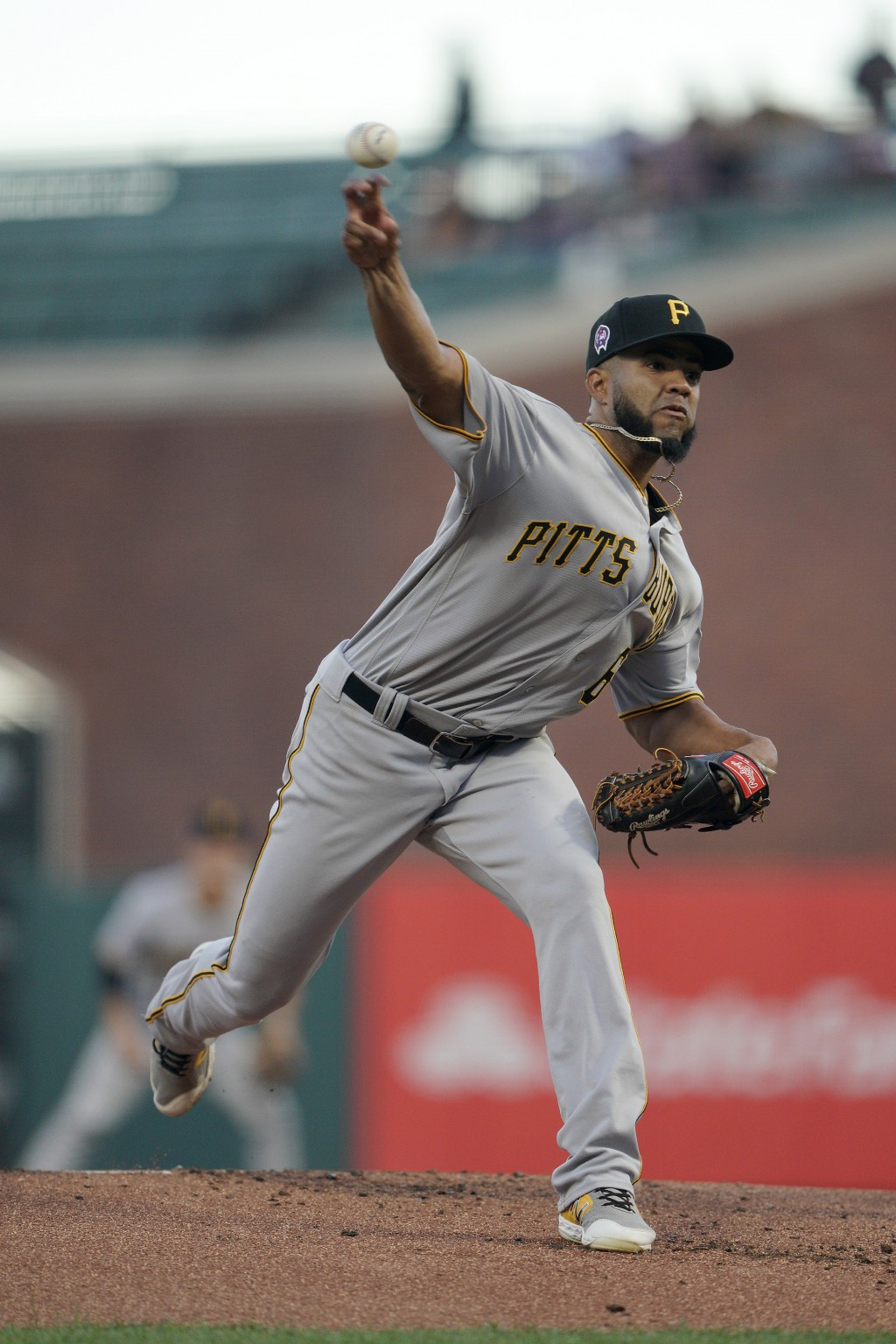 Pittsburgh Pirates starting pitcher Dario Agrazal throws to a San Francisco Giants batter during the first inning of a baseball game Wednesday, Sept.