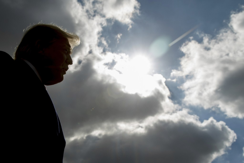 FILE - In this Oct. 27, 2018 file photo, President Donald Trump speaks to reporters in Indianapolis. An AP-NORC Center poll released on Thursday, Sept