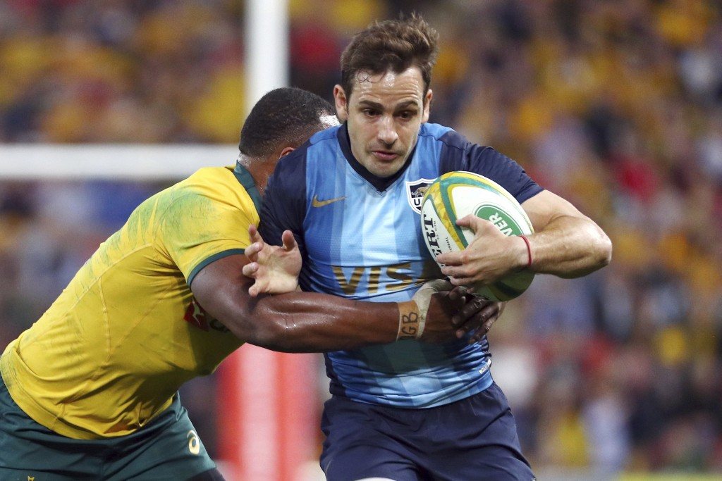 FILE - In this July 27, 2019, file photo, Argentina's Nicolas Sanchez, right, is tackled during a Rugby Championship match between Australia and Argen...