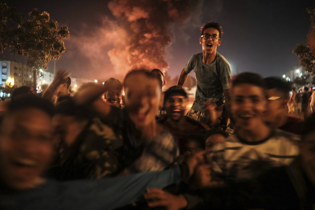 In this Monday, Sept. 9, 2019 photo, youths react during the celebration of Ashura, in Sale, near Rabat, Morocco. On Sept. 9, the Arab and Muslim worl...