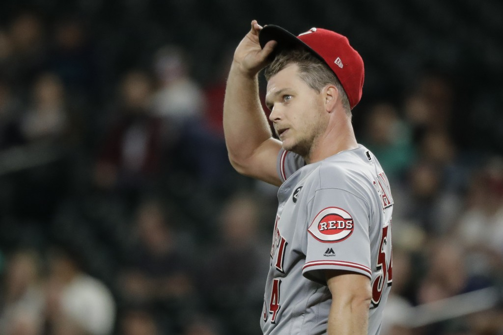 Cincinnati Reds starting pitcher Sonny Gray reacts on the mound after Seattle Mariners' Kyle Lewis ended Gray's no-hit bid in the seventh inning of a