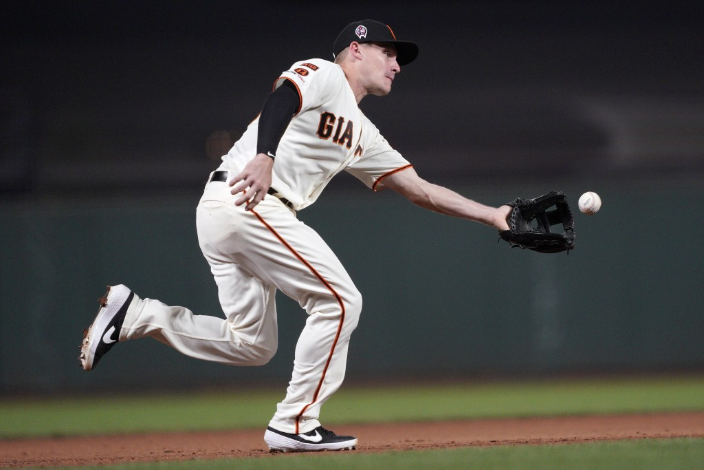 San Francisco Giants third baseman Corban Joseph fields a grounder hit by Pittsburgh Pirates' Dario Agrazal during the fifth inning of a baseball game...