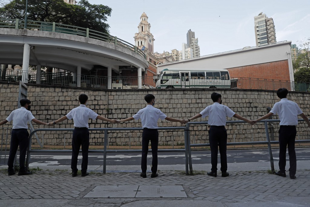 Students hold hands to surround St. Paul's College in Hong Kong, Monday, Sept. 9, 2019. Thousands of demonstrators in Hong Kong urged President Donald...