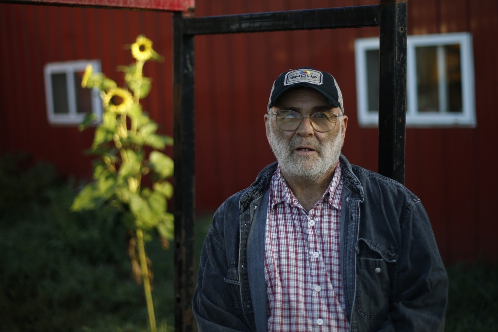 In this Thursday Aug. 15, 2019 photo, dairy farmer Fred Stone stands for a portrait at his farm in Arundel, Maine. Fred Stone and his wife, Laura, who