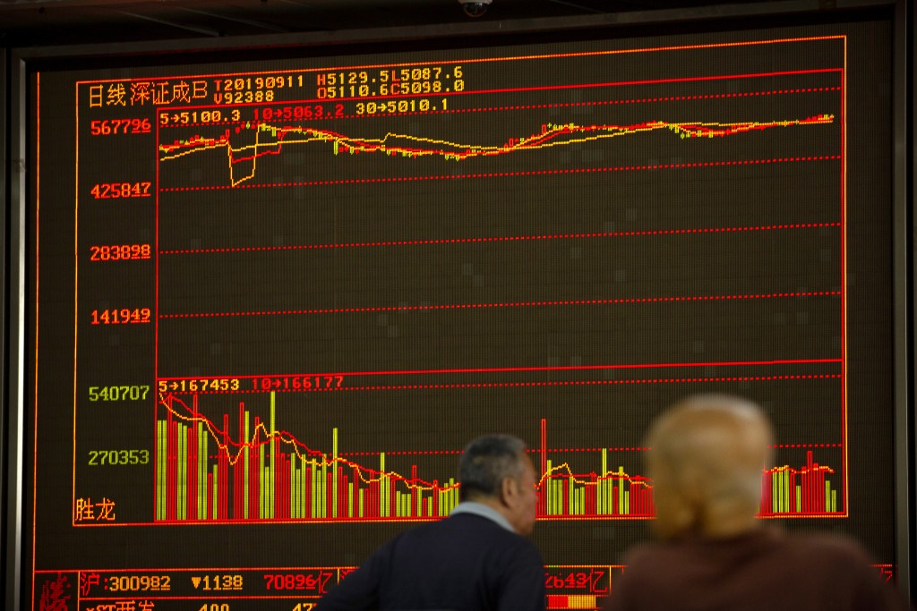 Chinese investors monitor stock prices at a brokerage house in Beijing, Wednesday, Sept. 11, 2019. Asian shares were mostly higher Wednesday, cheered