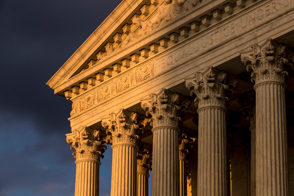FILE - In this Oct. 10, 2017, file photo, the Supreme Court in Washington is seen at sunset. The Supreme Court is allowing nationwide enforcement of a