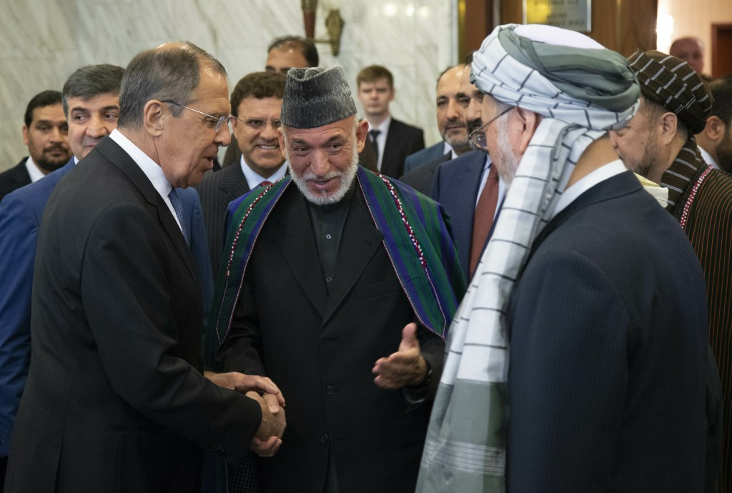 FILE - In this May 28, 2019 file photo, Former Afghan President Hamid Karzai, center, introduces the Taliban delegation to Russian Foreign Minister Se