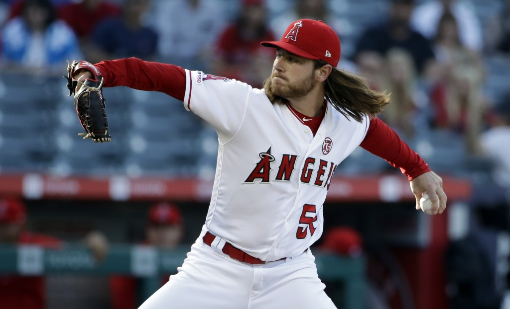 Los Angeles Angels starting pitcher Dillon Peters throws to a Cleveland Indians batter during the first inning of a baseball game Wednesday, Sept. 11,