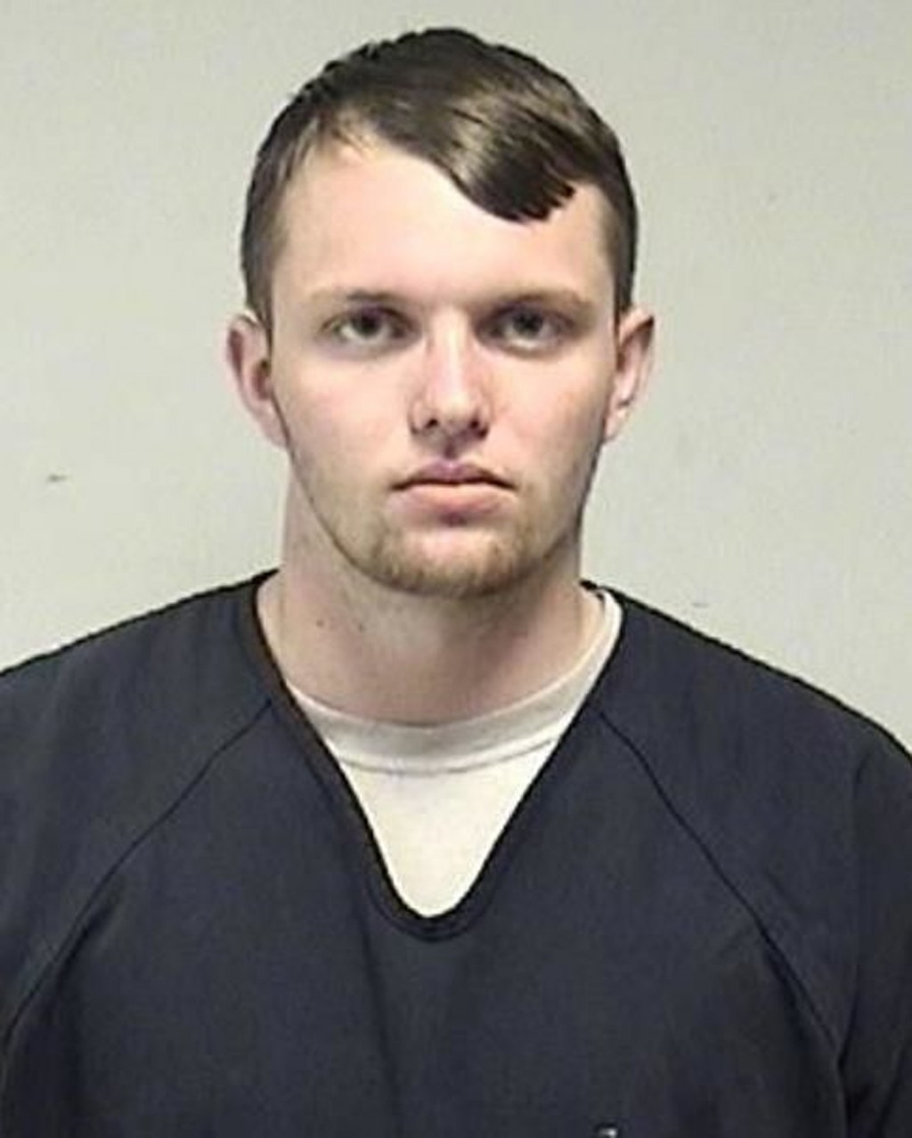 In this photo provided by the Kenosha County Sheriff's Office, Tyler Huffhines is pictured in a booking photo. Huffhines is accused of manufacturing t