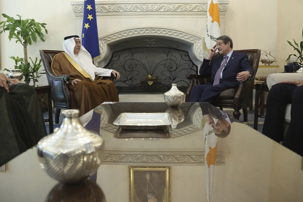 Cyprus' president Nicos Anastasiades, right, and Saudi Foreign Minister Ibrahim Bin Abdulaziz Al-Assaf talk during their meeting at the presidential p...
