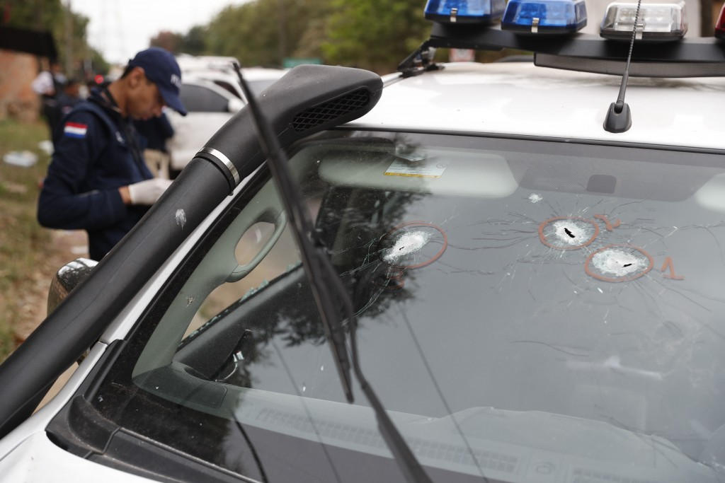 Bullet holes are seen on the windshield of the car used by police officer Felix Ferrari, who died in a shootout when jailed drug lord Jorge Teofilo Sa...