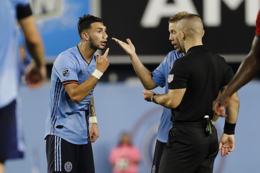 New York City FC's Valentin Castellanos, left, argues with a referee after being injured during the second half of an MLS soccer match against Toronto