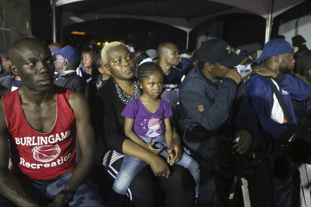 Nigerian returnees from South Africa due to recently violence targeted at foreigners sit upon arrival on an Air Peace airline at the Murtala Muhammed ...