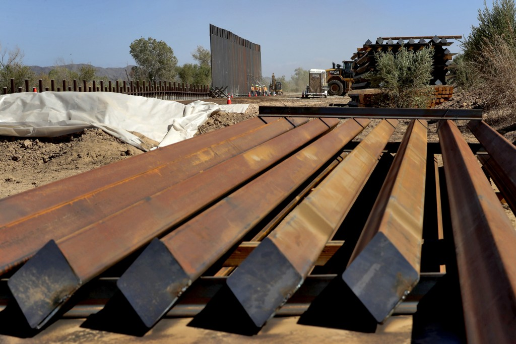 Sections of Pentagon-funded border wall are stacked prior to installation along the Colorado River, Tuesday, Sept. 10, 2019 in Yuma, Ariz. A 30-foot h...