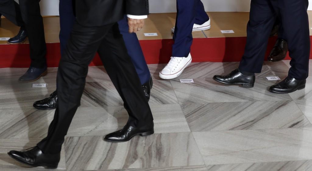 Albanian Prime Minister Edi Rama, wearing sport shoes, arrives for the V4+West Balkan summit in Prague, Czech Republic, Thursday, Sept. 12, 2019. (AP