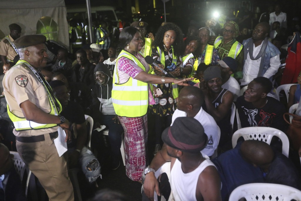 Abike Dabiri Erewa, center, chairman of the Nigerians in Diaspora Commission, speaks to Nigerian returnees from South Africa upon arrival at the Murta...