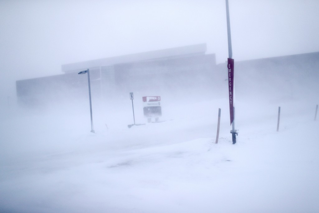 In this Feb. 21, 2019, photo, the entrance to Norton Sound Regional Hospital is seen through a snow storm in Nome, Alaska. The hospital serves Nome an...