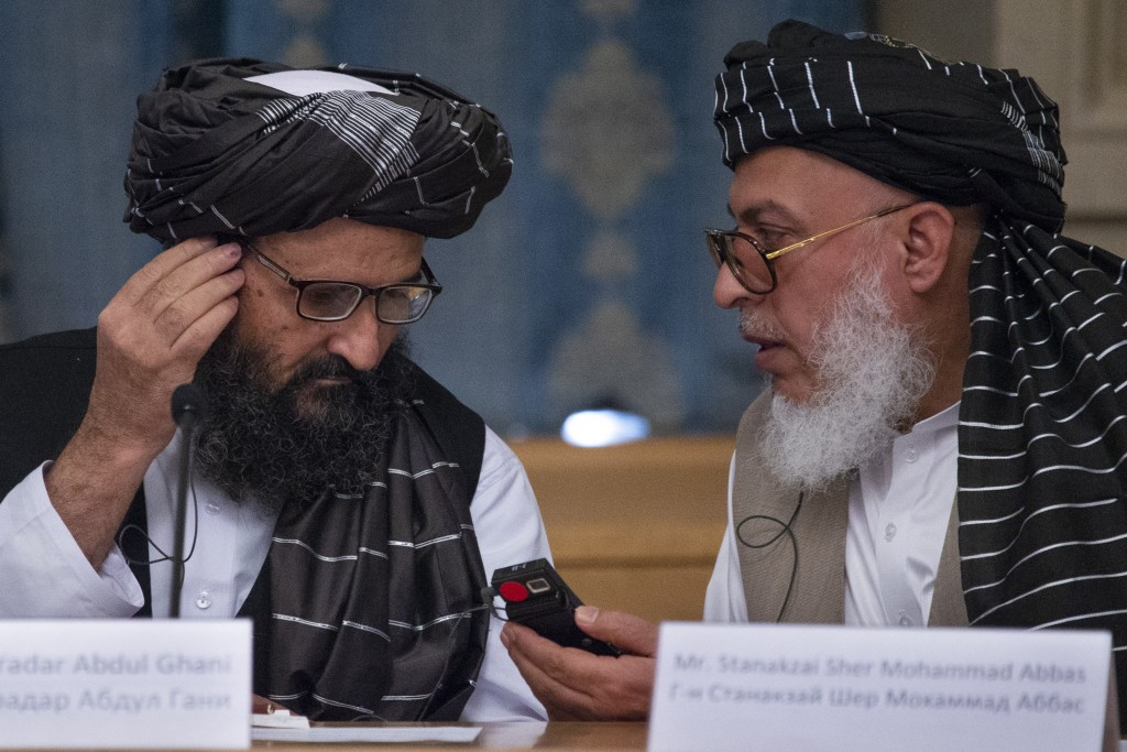 FILE - In this May 28, 2019 file photo, Mullah Abdul Ghani Baradar, the Taliban group's top political leader, left, and Sher Mohammad Abbas Stanikzai,