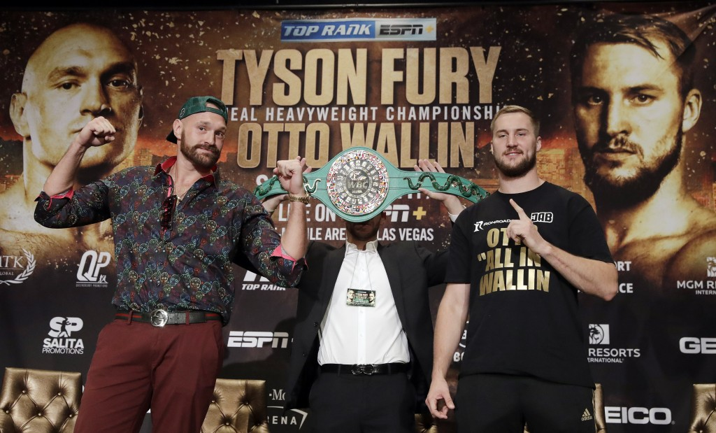 Tyson Fury, left, and Otto Wallin, of Sweden, pose for photos following a news conference Wednesday, Sept. 11, 2019, in Las Vegas. The pair will face