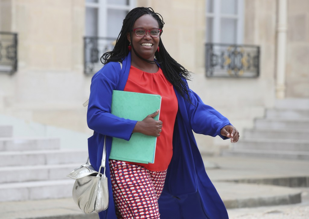 In this photo taken on Wednesday Sept. 4, 2019 French Government's spokesperson Sibeth Ndiaye leaves the cabinet meeting at the Elysee Palace in Paris