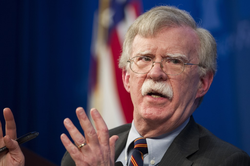 FILE - In this Dec. 13, 2018 file photo, national security adviser John Bolton unveils the Trump Administration's Africa Strategy at the Heritage Foun...