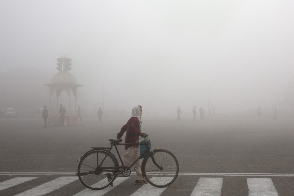 """FILE - This Jan. 18, 2019 file photo shows a cyclist amidst morning smog in New Delhi, India. Beth Gardiner's new book """"Choked"""" documents how air poll..."""