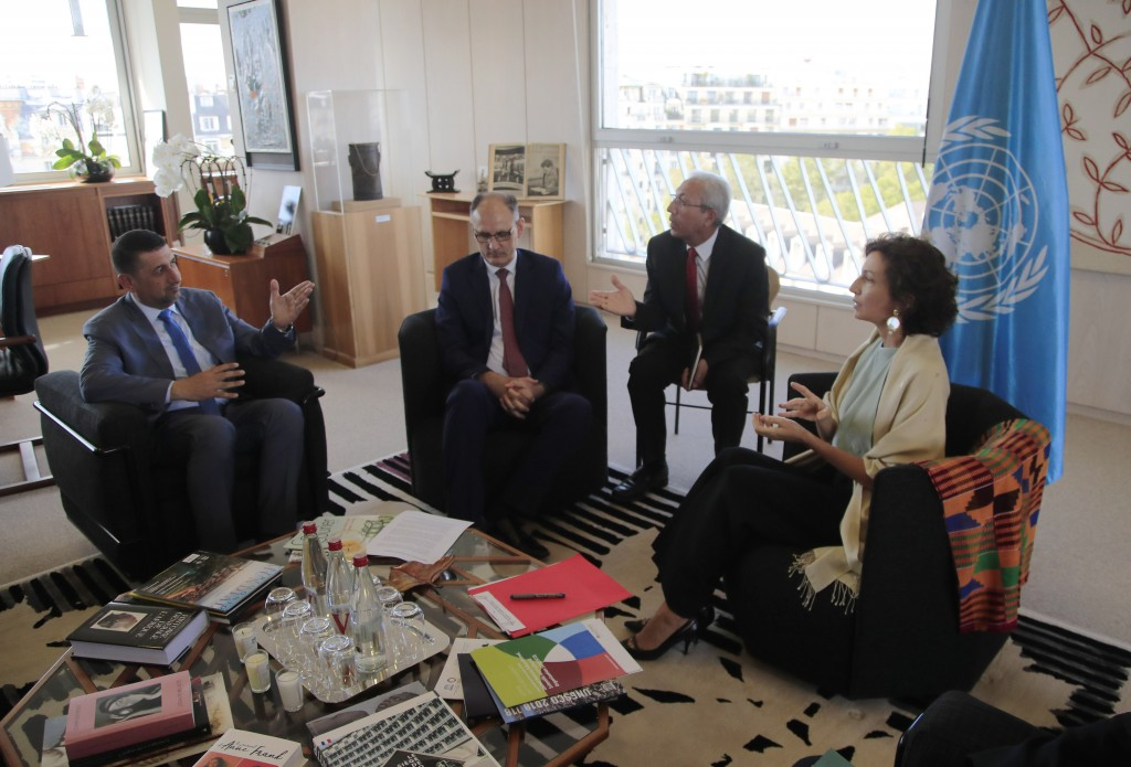Governor of the province Nineveh Mansour al-Mareed, left, and Iraq's Culture Minister Abdulamir al-Dafar Hamdani, center, meet UNESCO'S Director-Gener...