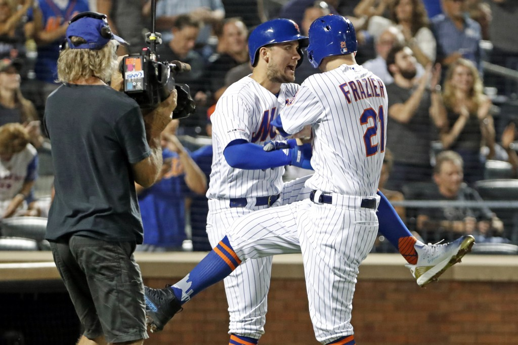 New York Mets' J.D. Davis celebrates with Todd Frazier, right, after scoring on Frazier's two-run home run during the first inning of the team's baseb...