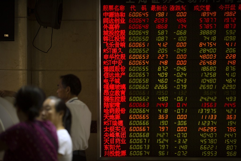 Chinese investors use computer terminals as they monitor stock prices at a brokerage house in Beijing, Wednesday, Sept. 11, 2019. Asian shares were mo...