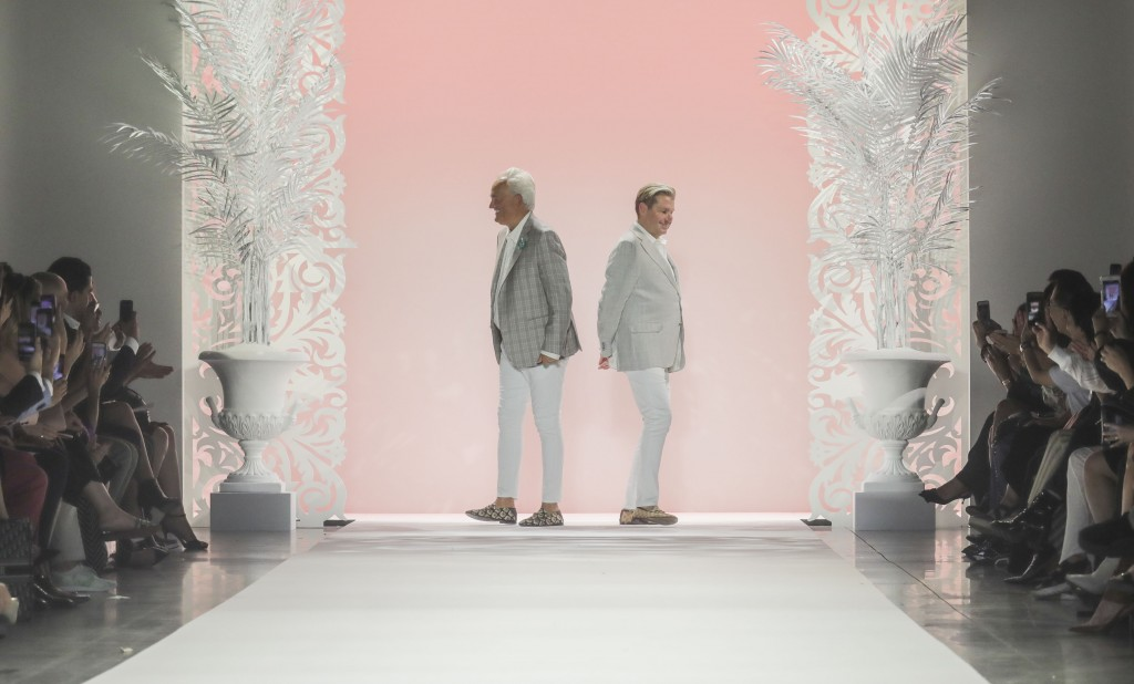 Fashion designers Mark Badgley, left, and James Mischka appear on the runway after showing their latest creations, during New York Fashion Week, Wedne
