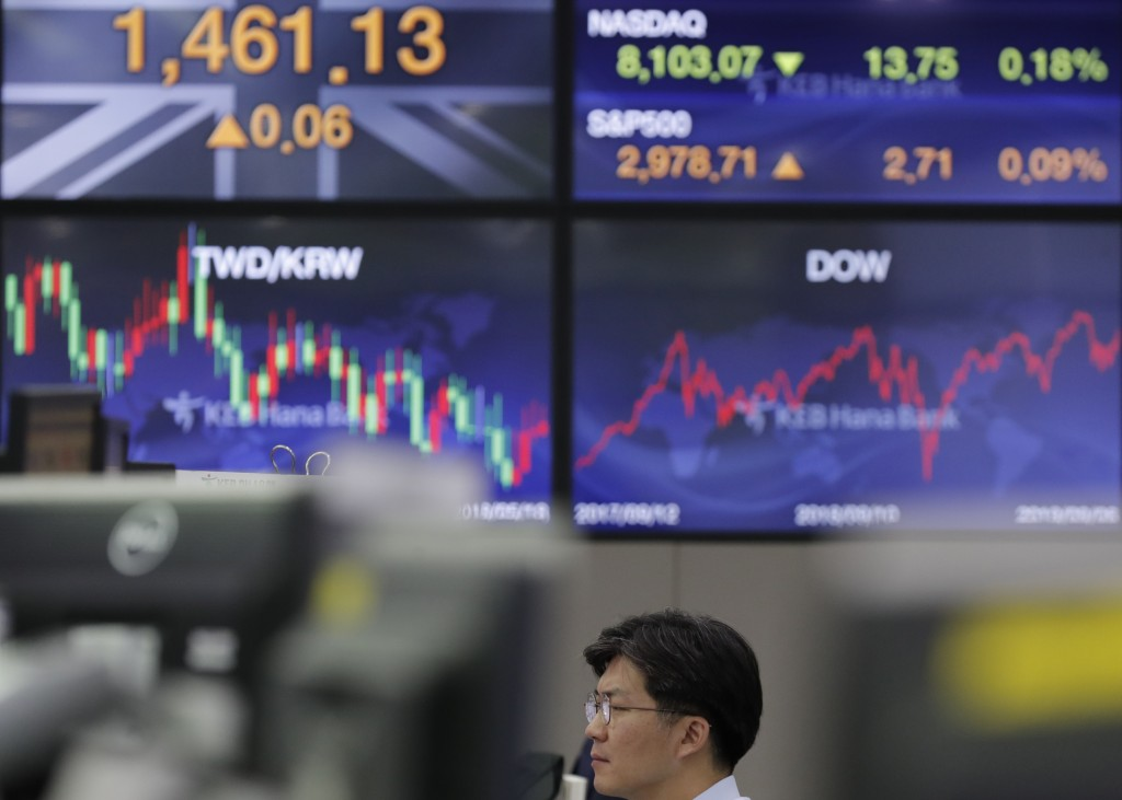 A currency trader watches computer monitors at the foreign exchange dealing room in Seoul, South Korea, Monday, Sept. 9, 2019. (AP Photo/Lee Jin-man)