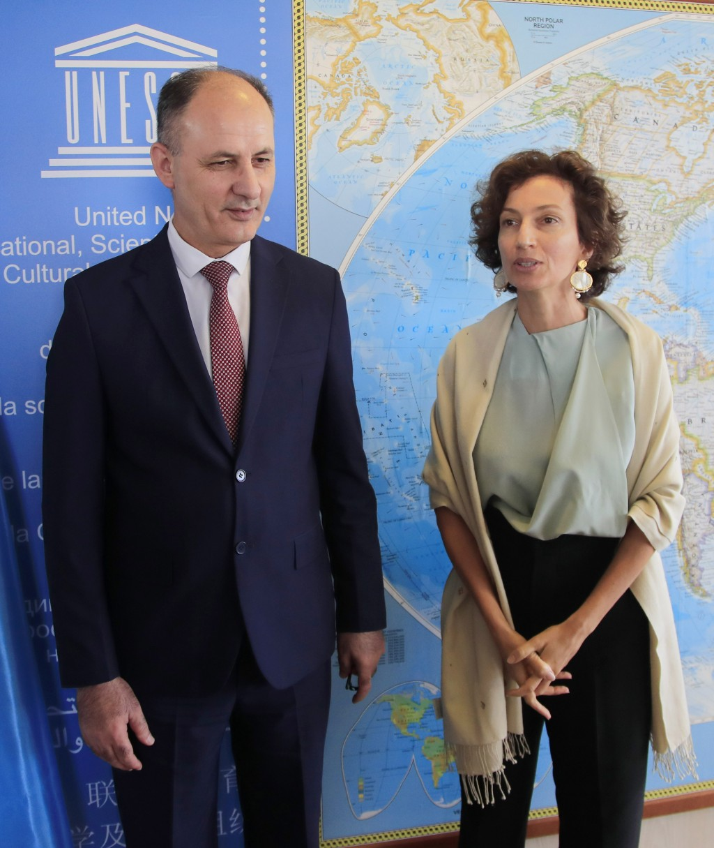 Iraq's Culture Minister Abdulamir al-Dafar Hamdani, left, is welcomed by UNESCO'S Director-General Audrey Azoulay at the UNESCO's headquarters in Pari...