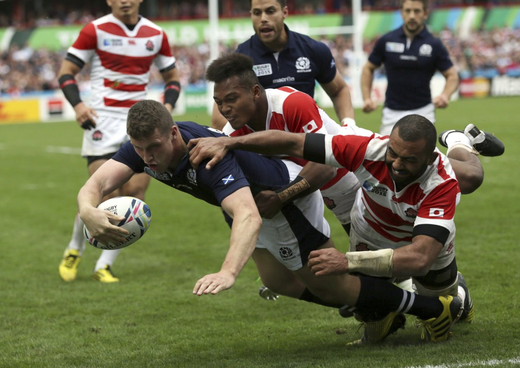 FILE - In this  Wednesday, Sept. 23, 2015 file photo, Scotland's Mark Bennett scores a try during the Rugby World Cup Pool B match between Scotland an