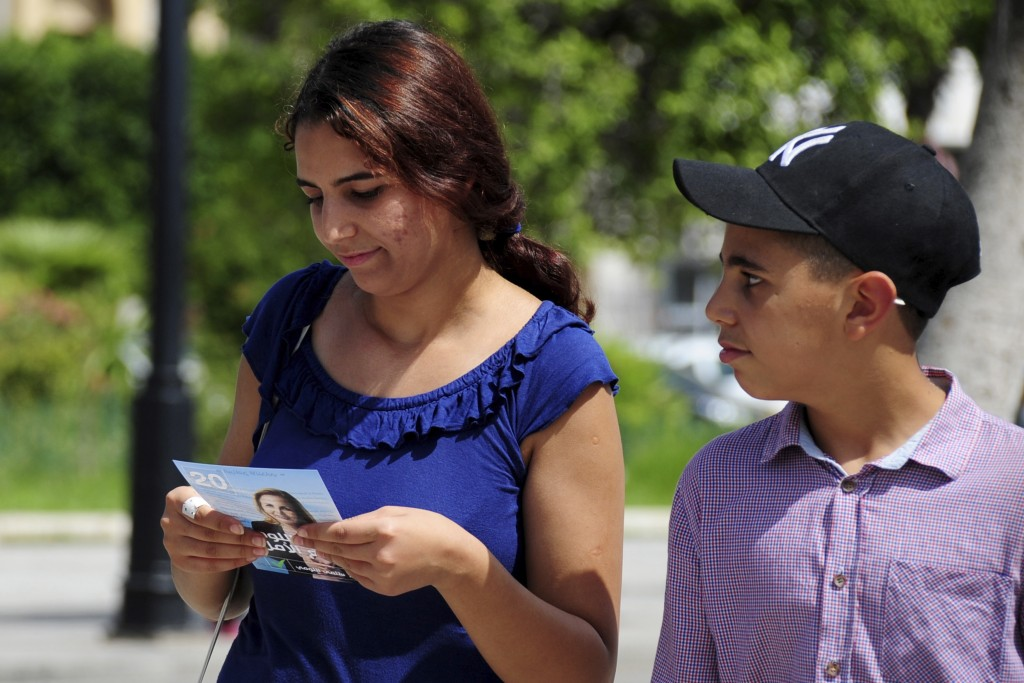 People read campaign leaflets for Tunisian preside...