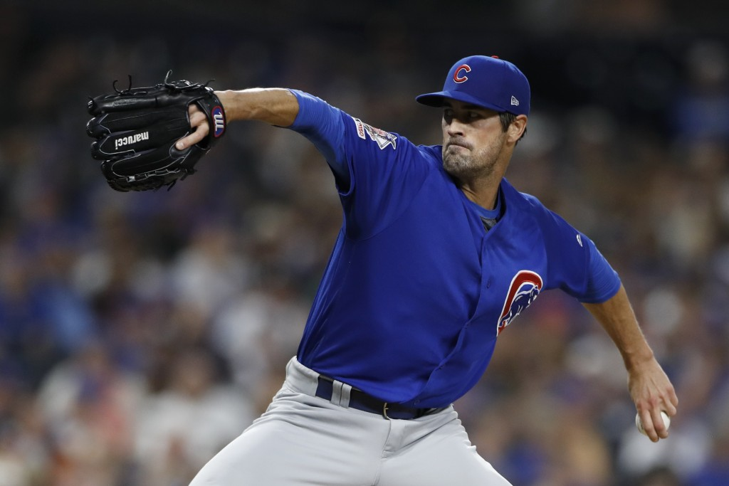 Chicago Cubs starting pitcher Cole Hamels works against a San Diego Padres batter during the fourth inning of a baseball game Wednesday, Sept. 11, 201...
