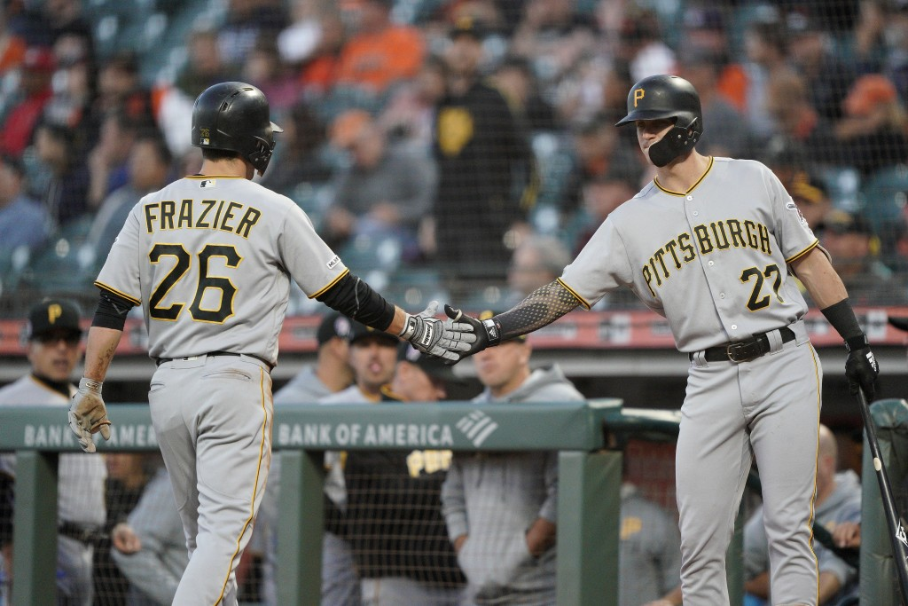 Pittsburgh Pirates' Kevin Newman (27) congratulates Adam Frazier (26) after he scored on a single by Kevin Kramer against the San Francisco Giants dur...